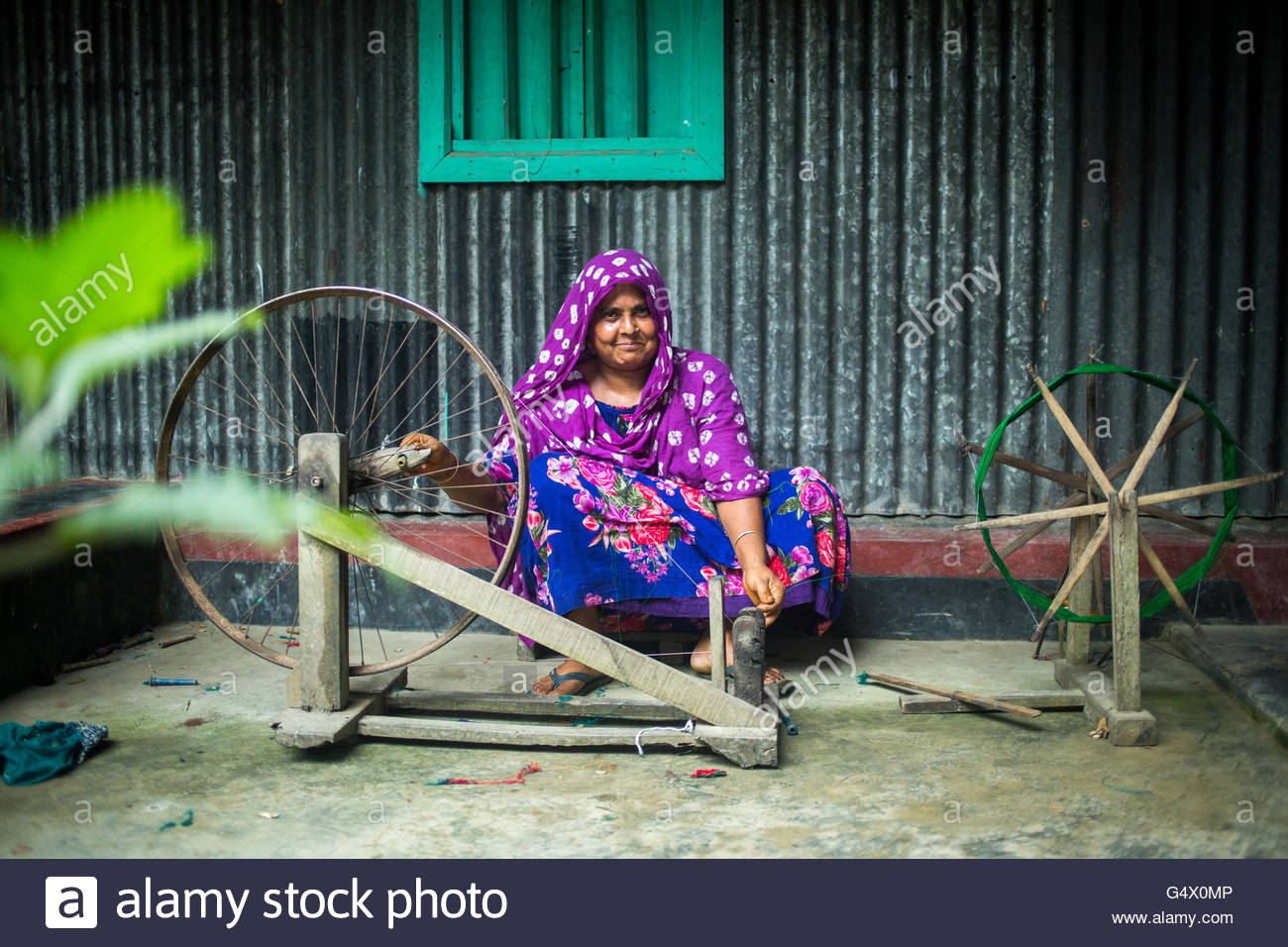 a women waving yarn  to make traditional saree in Tangail,Bangladesh. - Stock Image