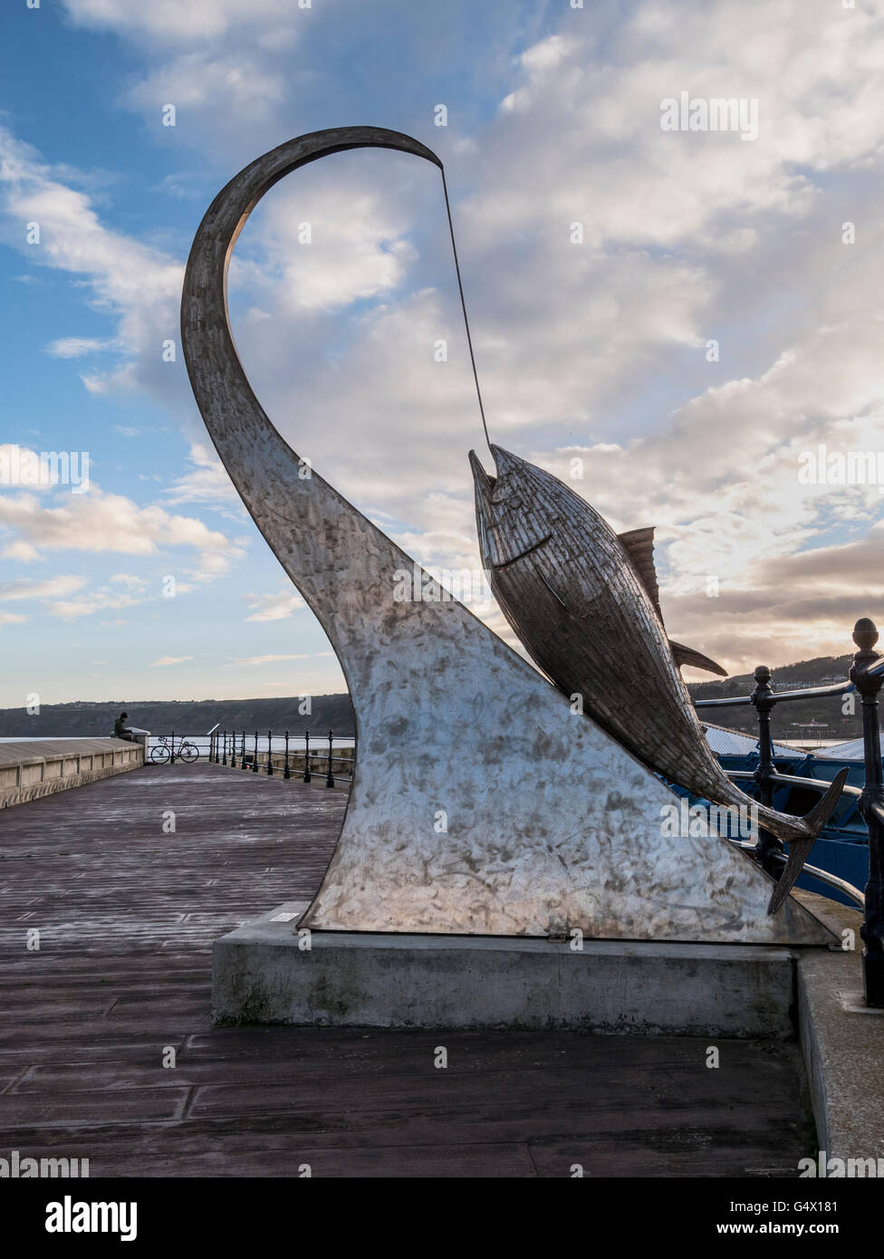 Tunny Sculpture by Ray Lonsdale on Outer Harbour Wall Scarborough Yorkshire UK. Donated by Maureen and Michael Robinson - Stock Image