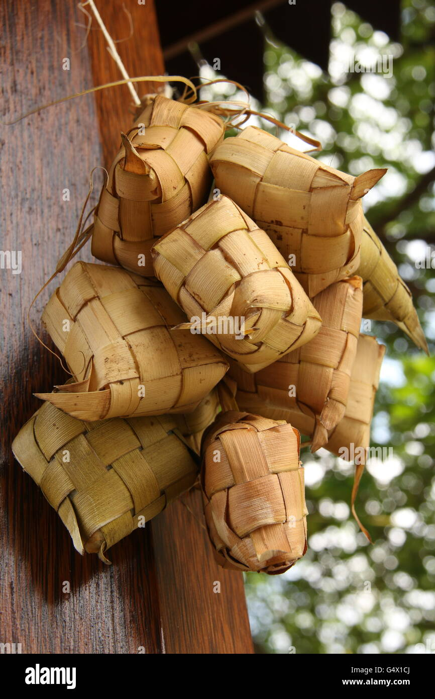 Ketupat or diamond shape rice cake; hung after cooking to drip dry. - Stock Image
