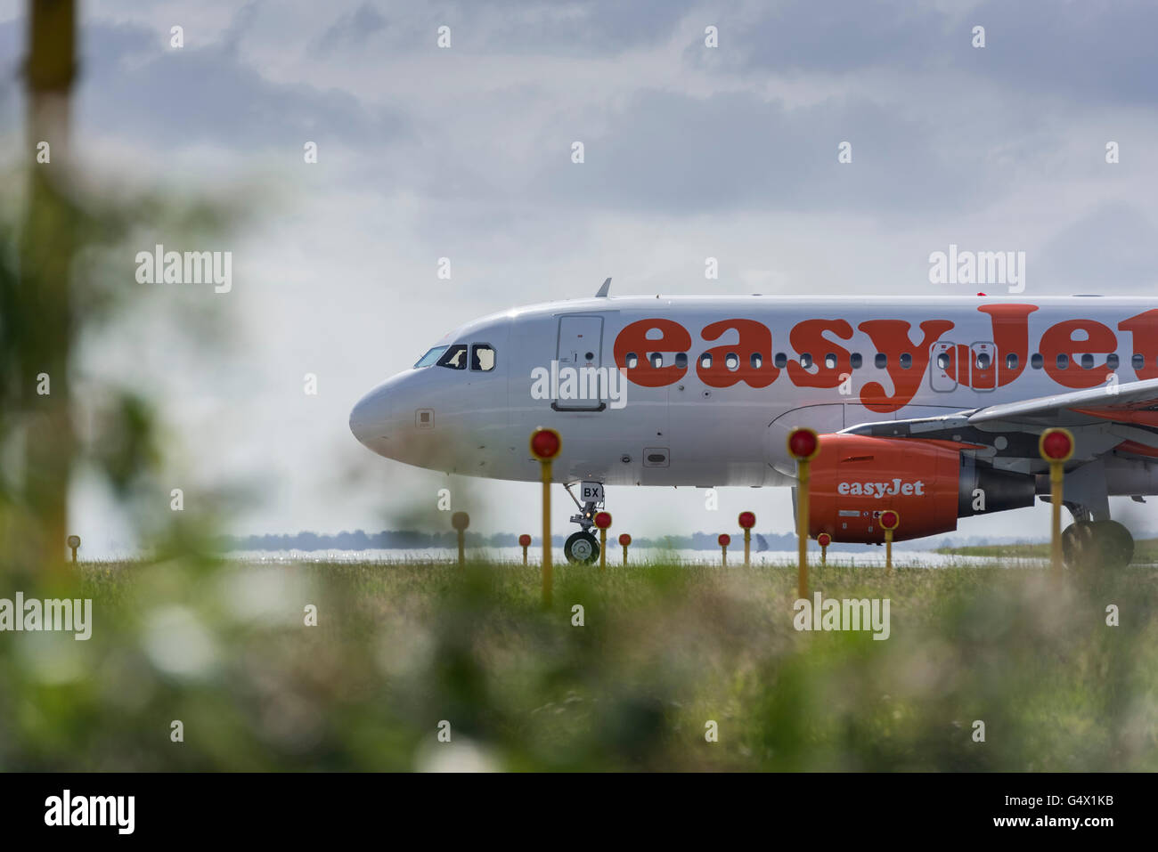 EasyJet Airline Airbus A319 aircraft Reg G-EZBX lined up for takeoff. - Stock Image