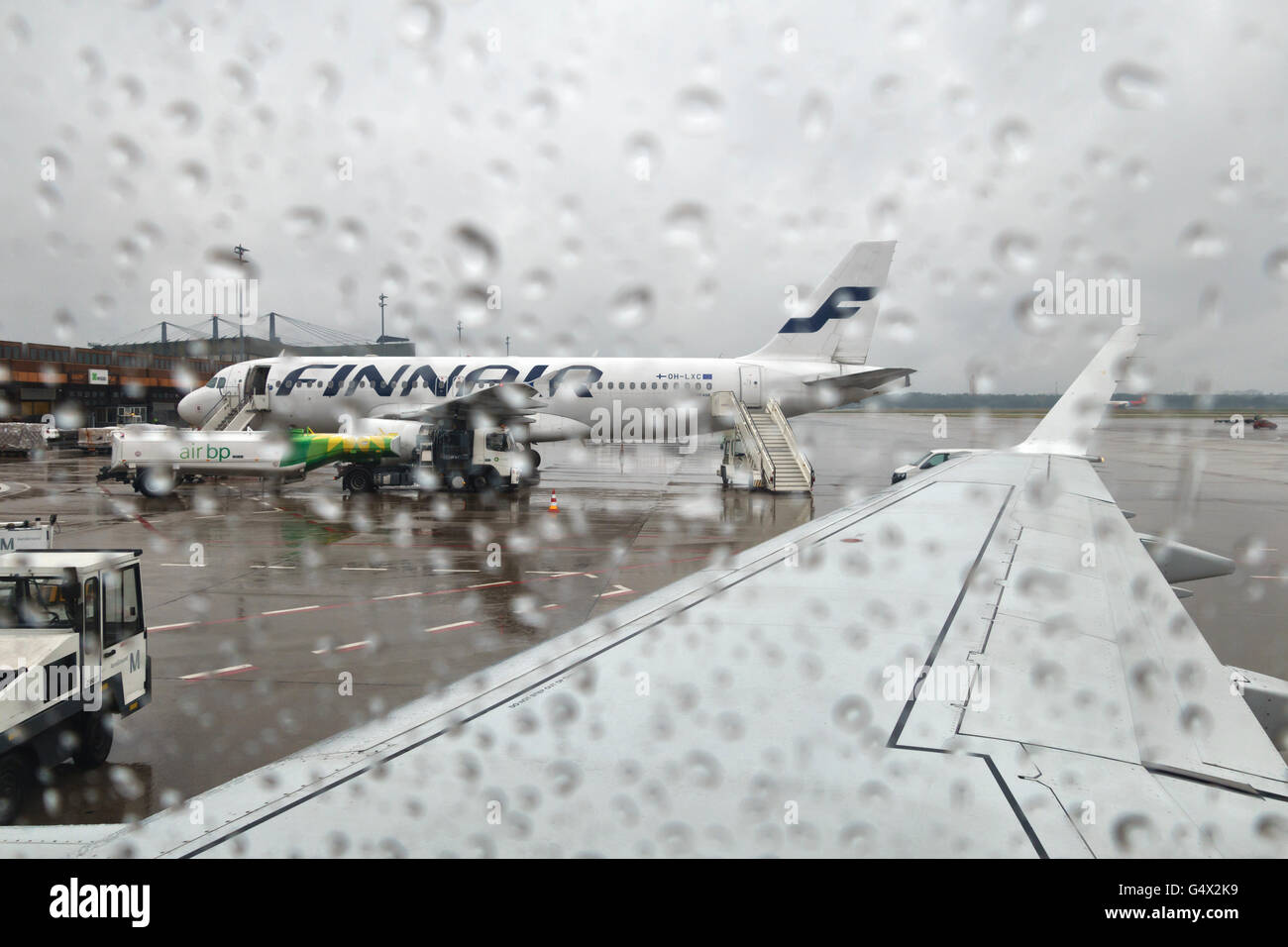 Tegel Airport, Berlin, Germany. A rainy day on the airfield - Stock Image