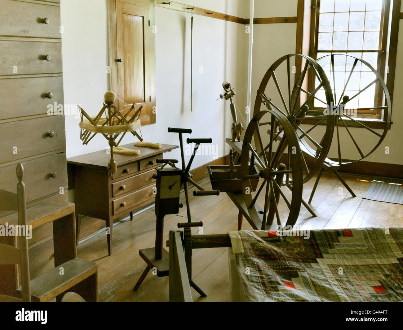 Old spinning wheel display, Hancock Shaker Village, Massachusetts Stock Photo