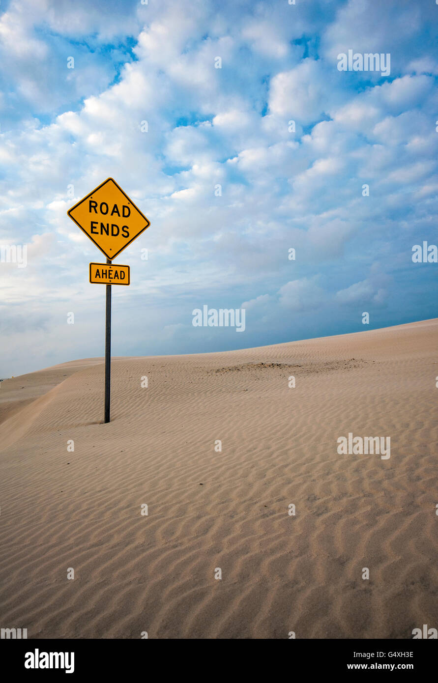Road Ends sign in dunes on South Padre Island, Texas, USA - Stock Image