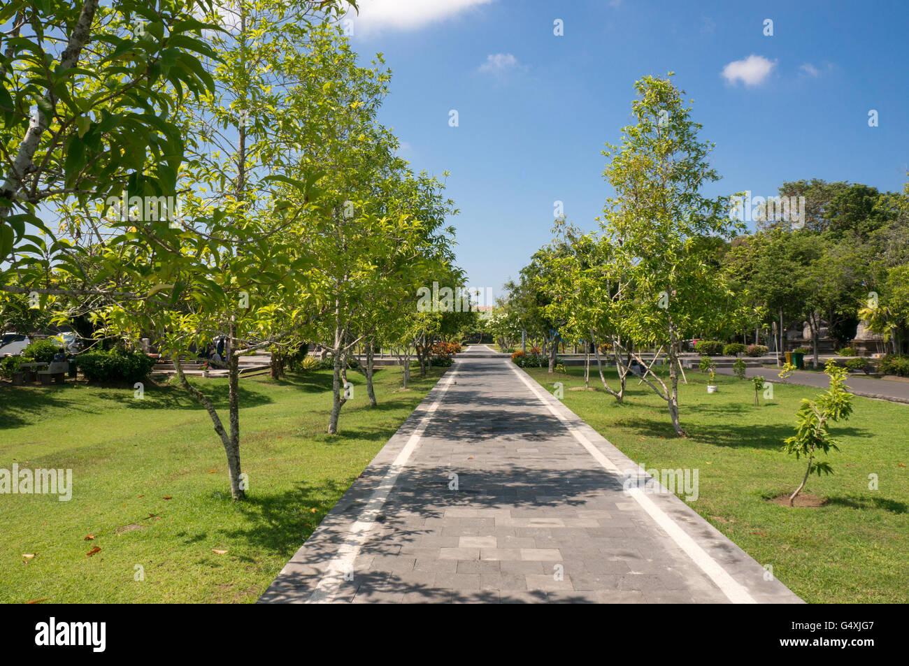 Narrow Path in the Garden around Bajra Sandhi Monument in Denpasar, Bali - Stock Image