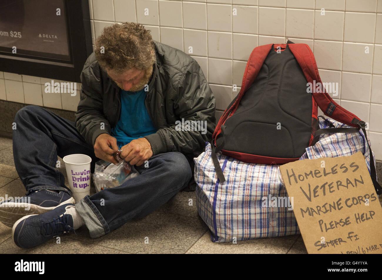 Homeless Marine Corps veteran on the street in New York City. - Stock Image