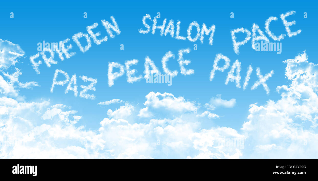 multilingual peace message written with cloud fonts on blue heaven background, - Stock Image
