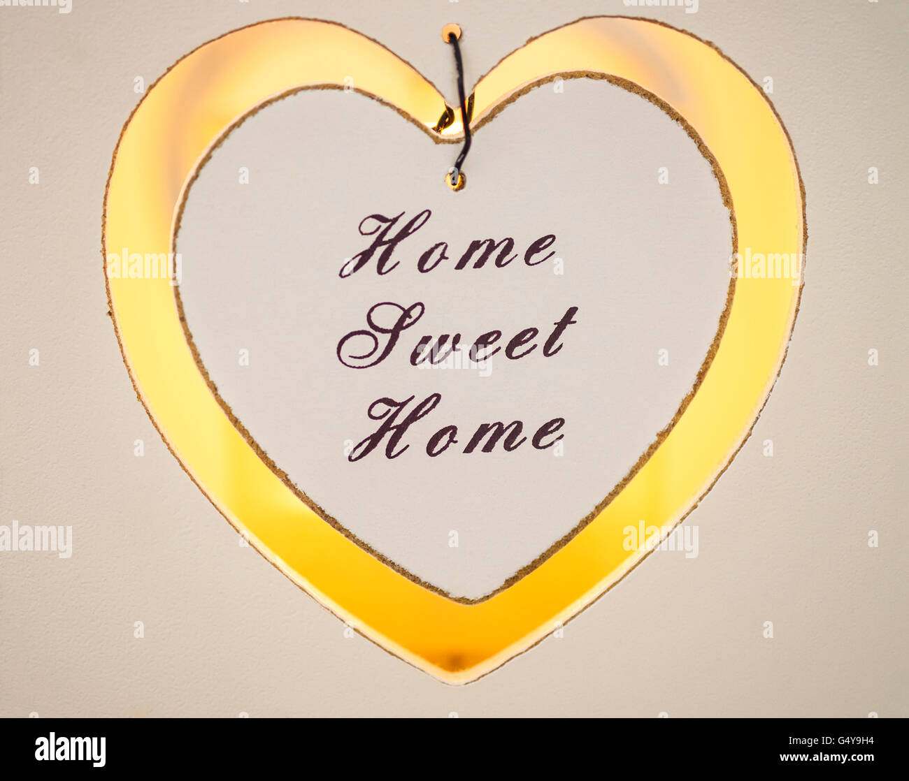 Home Sweet Home candle votive with candlelight - Stock Image