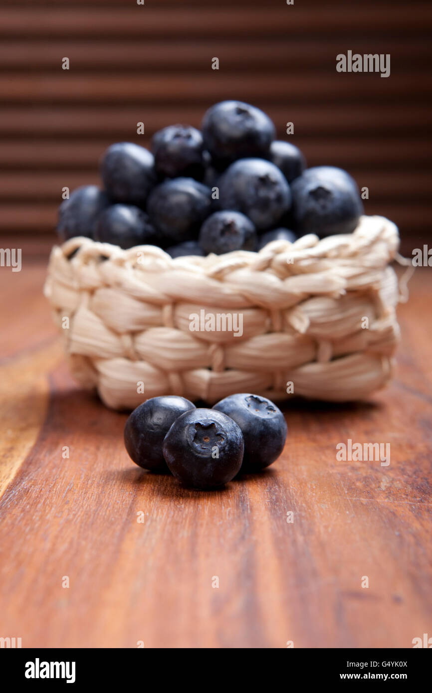 ripe blueberry fruits on rustic wooden table, close-up - Stock Image