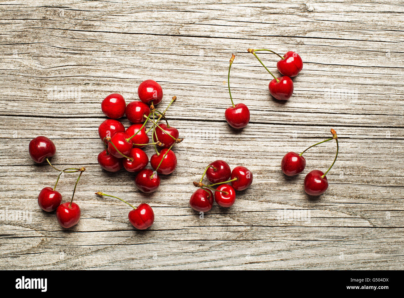 Fresh cherries on wooden table close up. - Stock Image