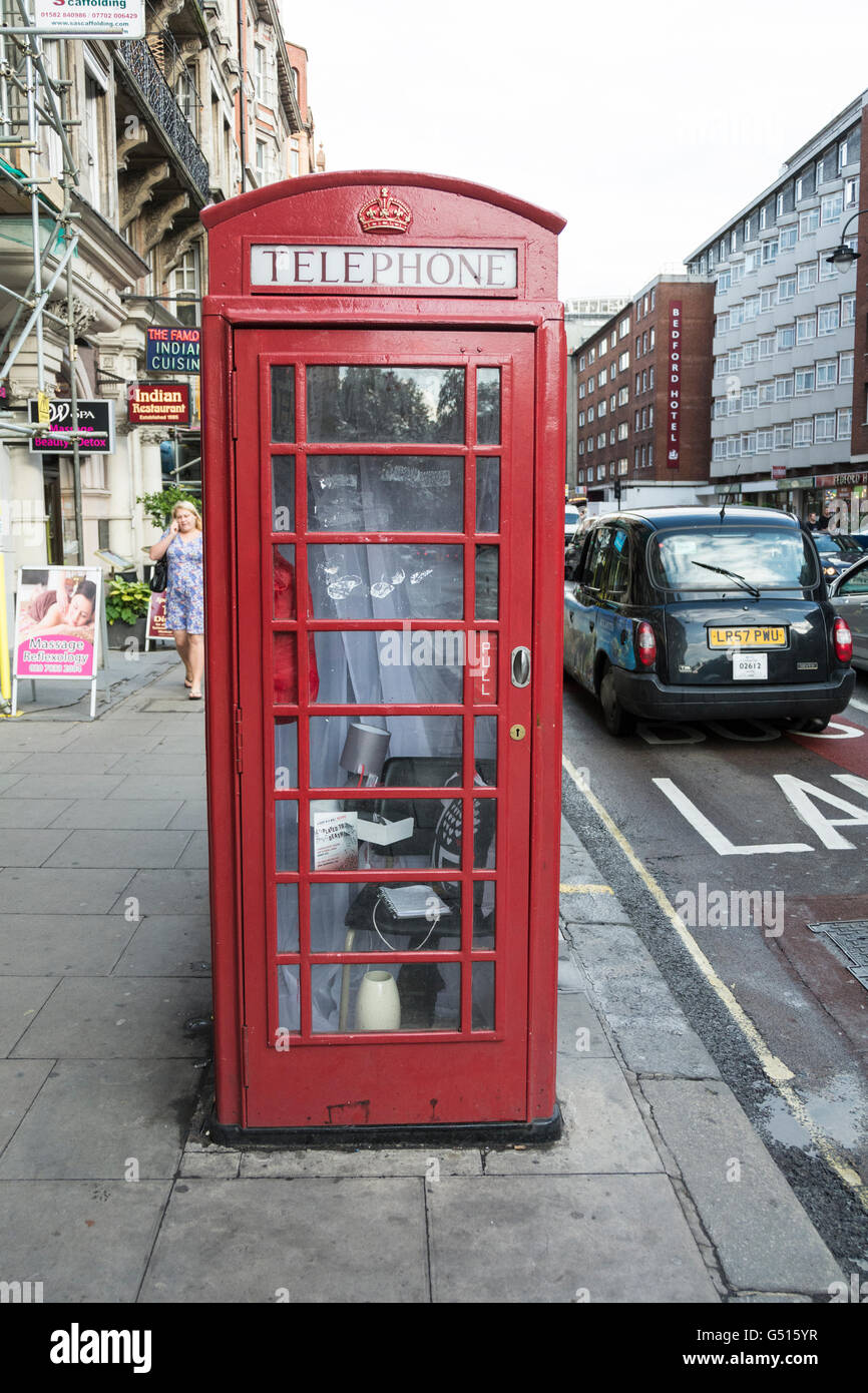 Played to Death telephone kiosk art in Bloomsbury, Central London, UK - Stock Image
