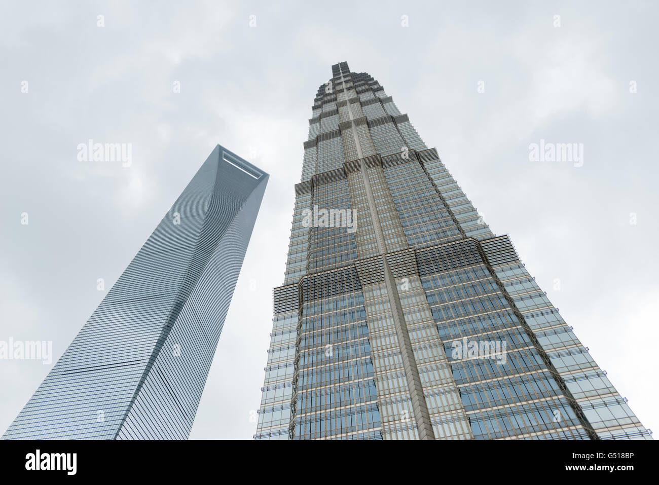 China, Shanghai, Shanghai World Financial Center and Jin Mao Tower from the frog perspective - Stock Image