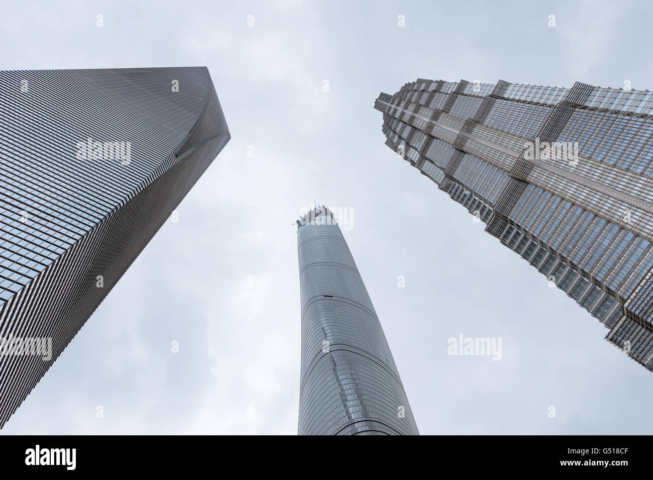 China, Shanghai, Shanghai World Financial Center, Shanghai Tower and Jin Mao Tower from the frog perspective - Stock Image