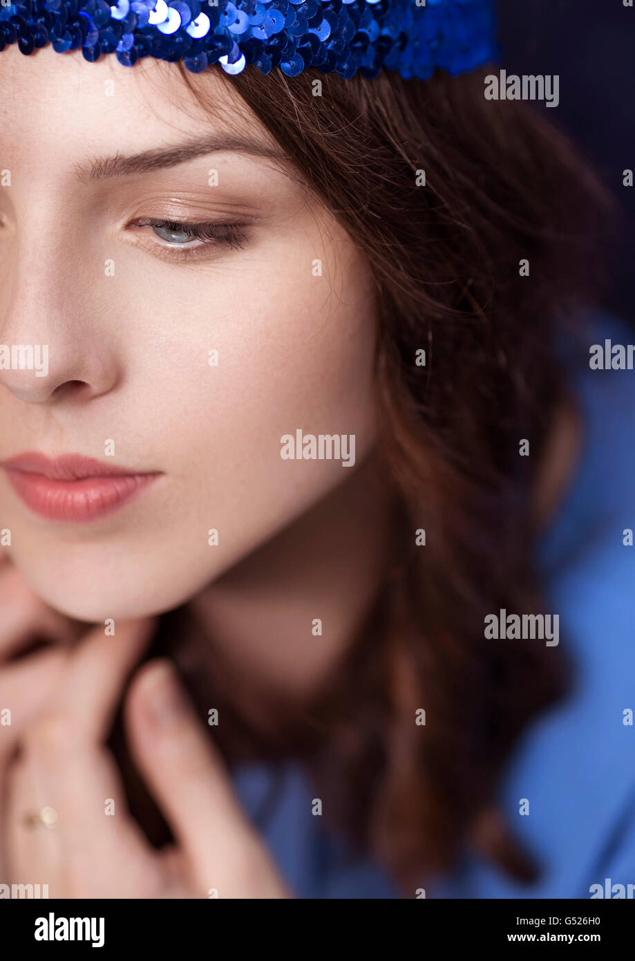 Closeup portrait of a girl with glittery blue ribbon Stock Photo