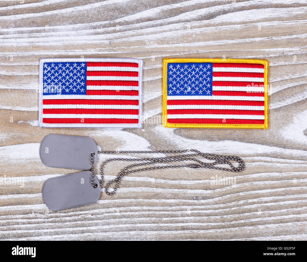 Small USA flag patches and military identification tags on