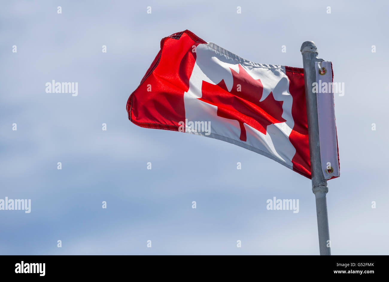 Canadian flag against a cloudy sky - Stock Image