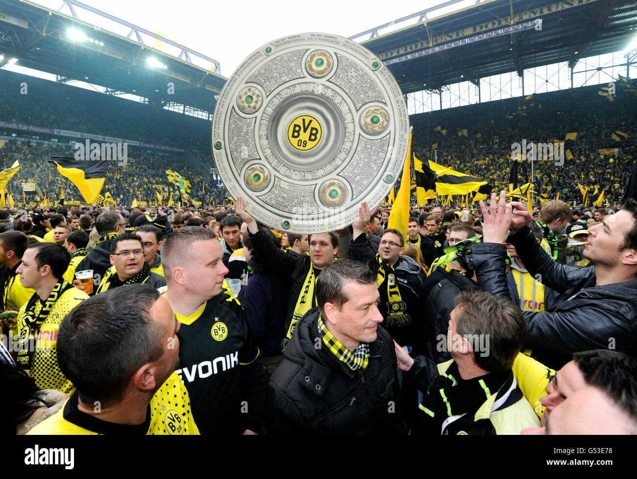 Football club BVB Borussia Dortmund fans on the pitch with a dummy of the league cup trophy, after match Borussia Stock Photo