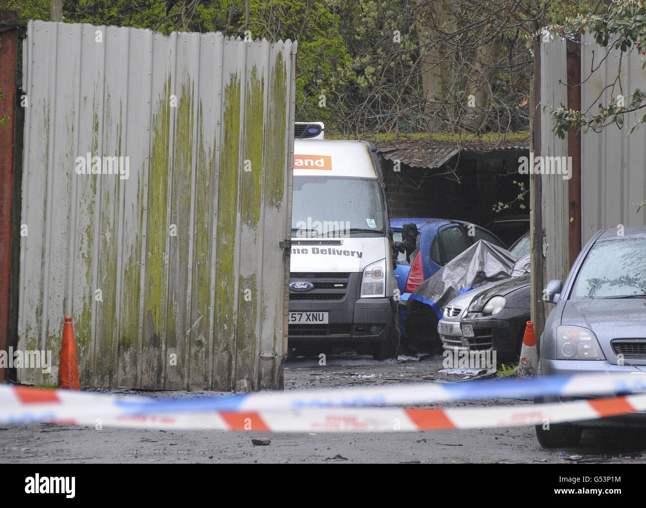 The scene at a salvage yard on Gravelly Lane, Erdington, Birmingham, after a body was discovered inside a car by Stock Photo
