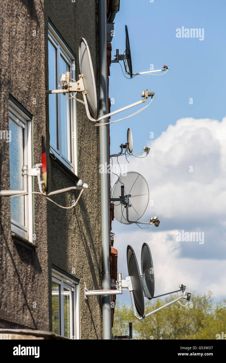 Many satellite antennas, satellite dishes at a house, - Stock Image