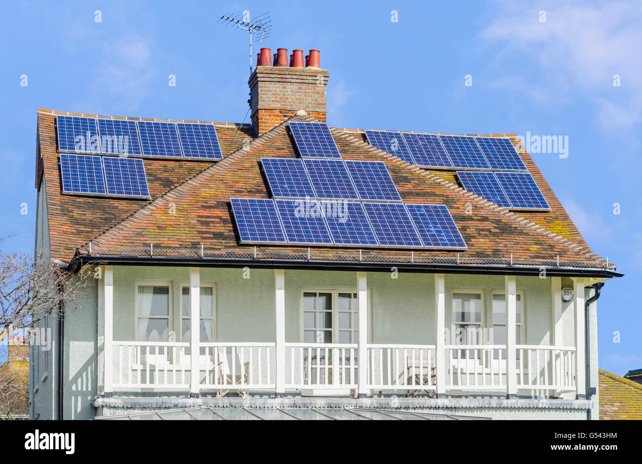 Solar panels on the roof of an old house in the UK. - Stock Image