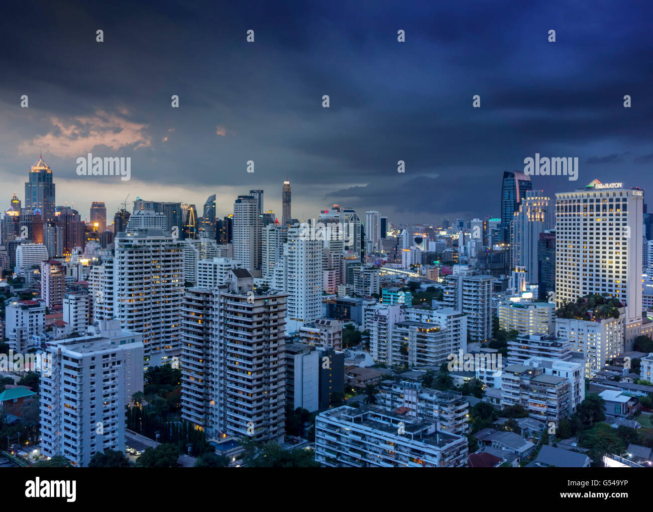 The Skyline of Bangkok with heavy monsoon clouds - Stock Image