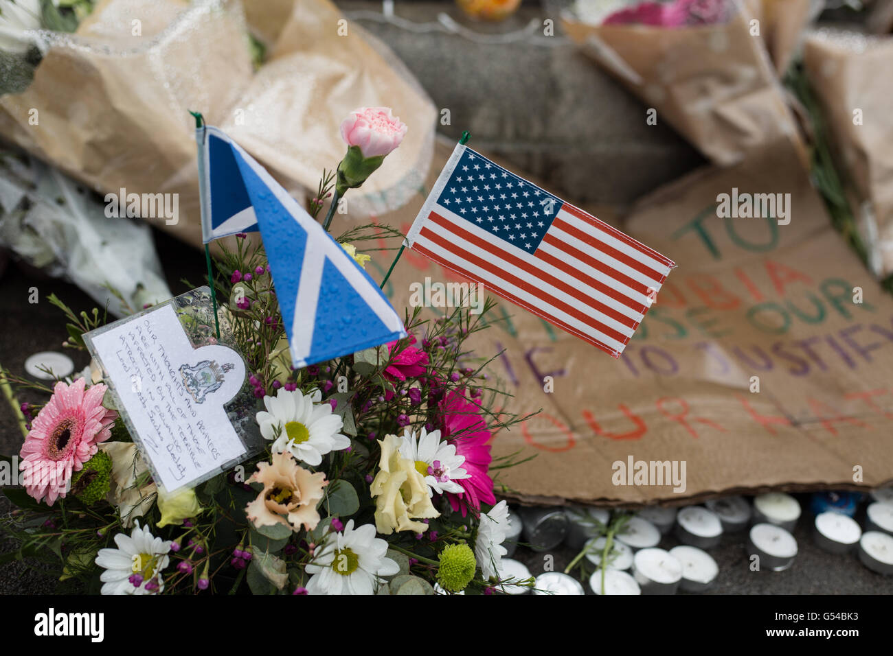 Flowers and tributes to victims of Orlando, Florida, LGBT nightclub shooting, in George Square, in Glasgow, Scotland, - Stock Image