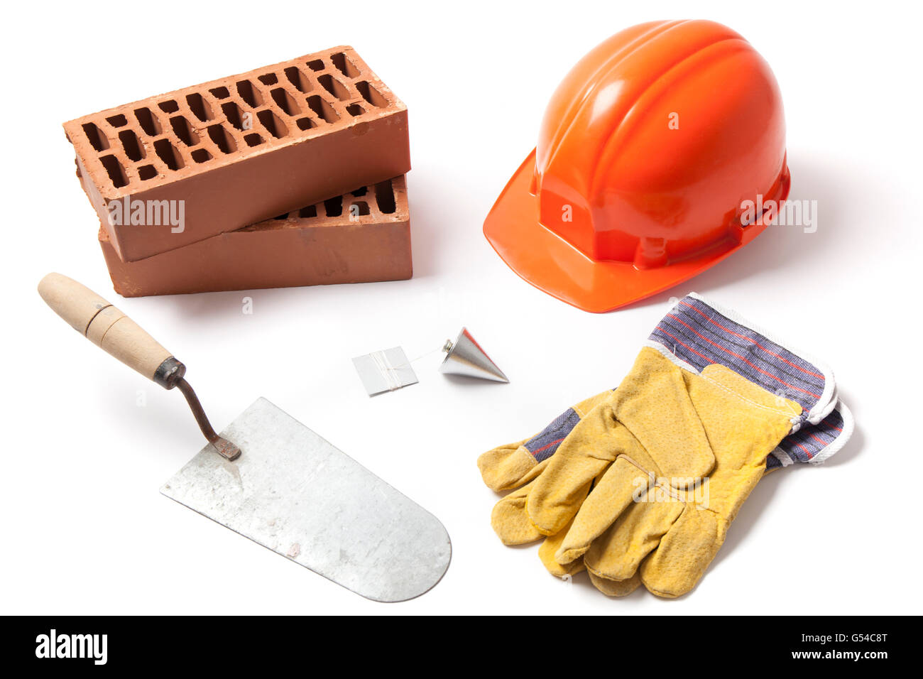 Several construction accessories trowel, bricks, plummet, hard hat and gloves isolated on white background. - Stock Image