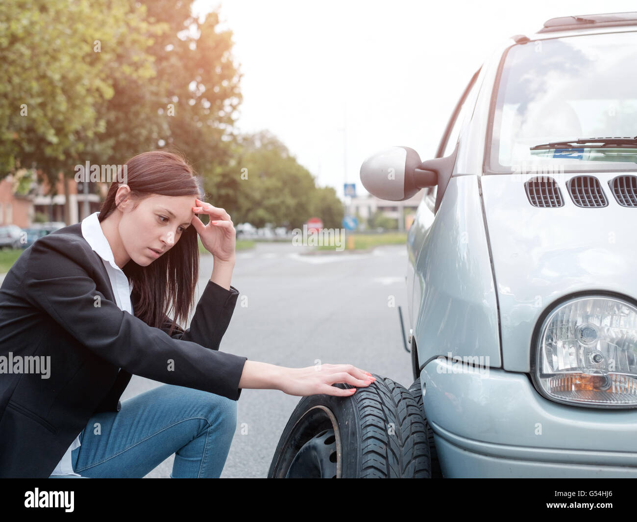 Sad woman after unexpected vehicle breakdown - Stock Image