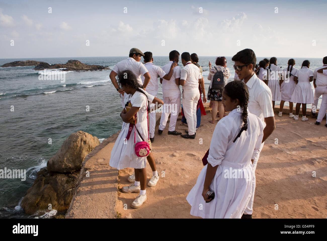 Sri Lanka, Galle Fort, group of secondary school children on Flag Rock ramparts overlooking sea - Stock Image