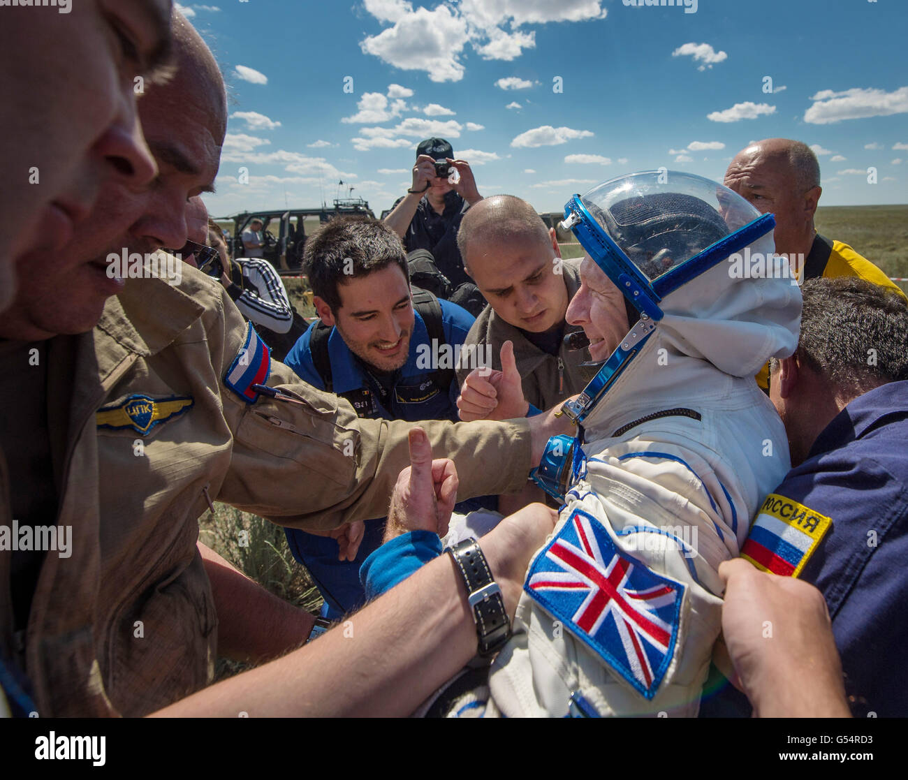 International Space Station Expedition 47 crew member European Space Agency astronaut Tim Peake is helped out of - Stock Image