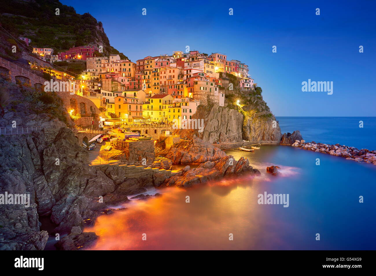 Manarola at evening night, Cinque Terre National Park, Liguria, Italy, UNESCO Stock Photo