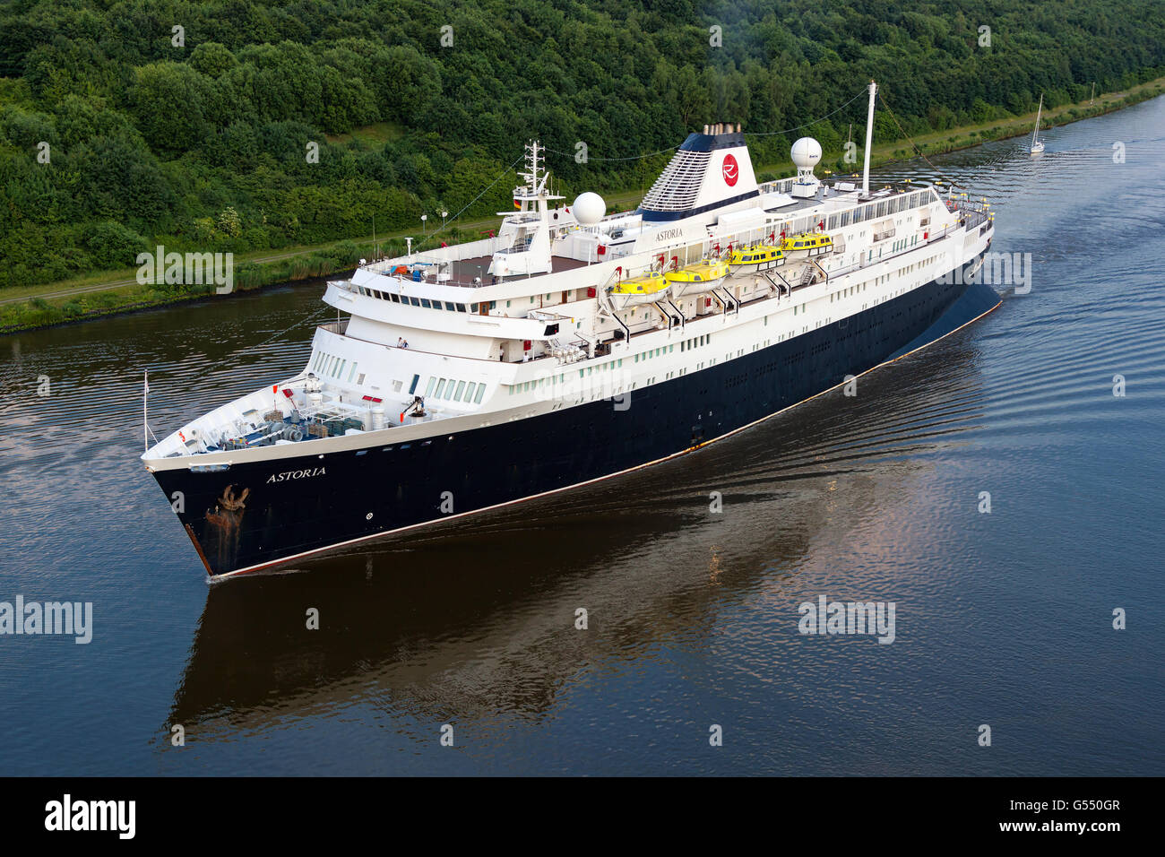 World's oldest active Ocean Liner Astoria (build in 1948) passing through the Kiel Canal on it's way from - Stock Image