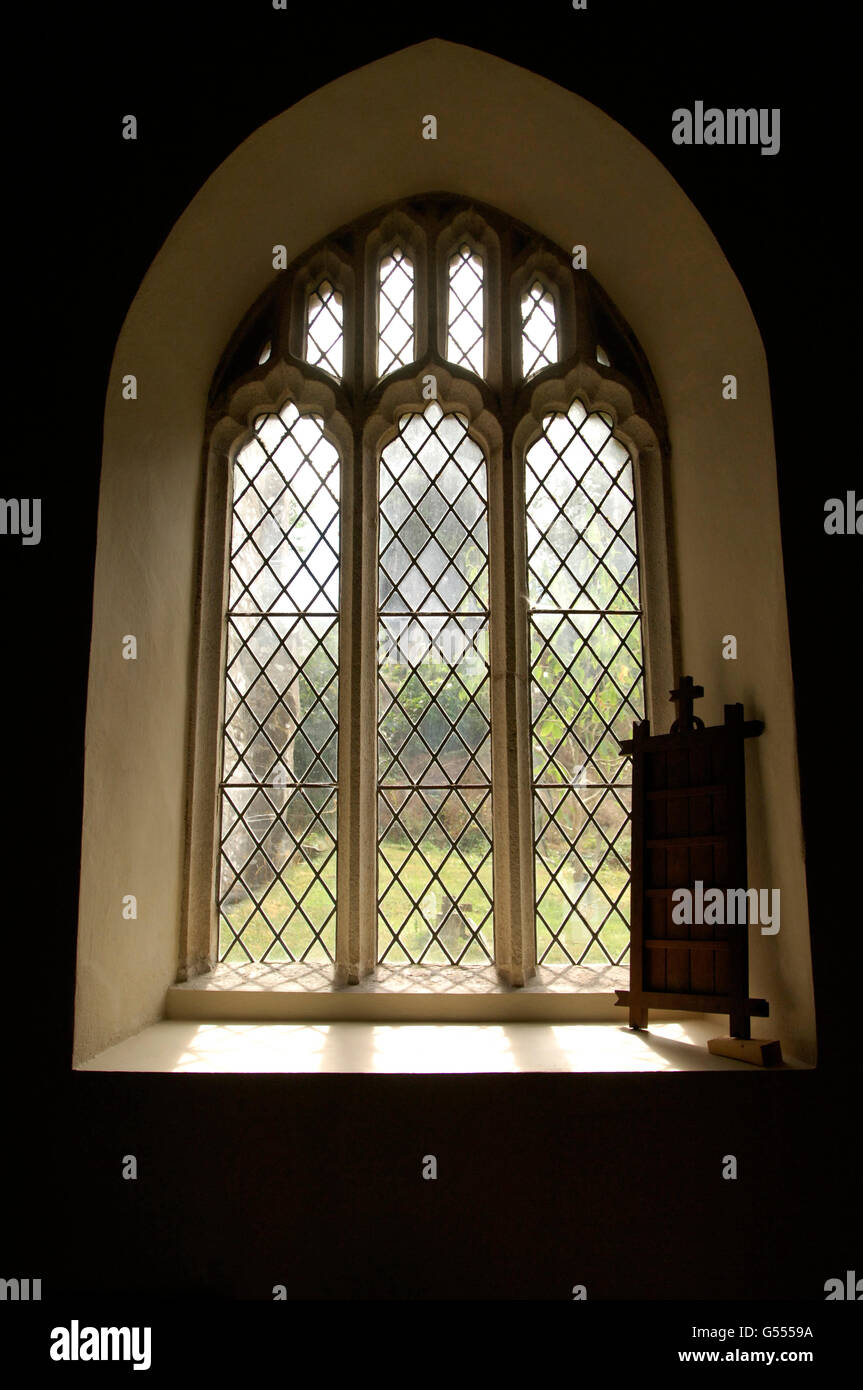Beautiful soft light pouring in through Church Window with psalms board in right hand corner of image Stock Photo