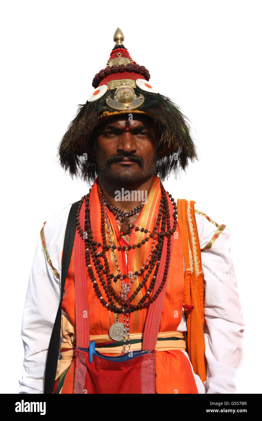A man traditionally dressed as 'Vasudev', a godly Hindu figure on the occassion of a festival in India. Stock Photo