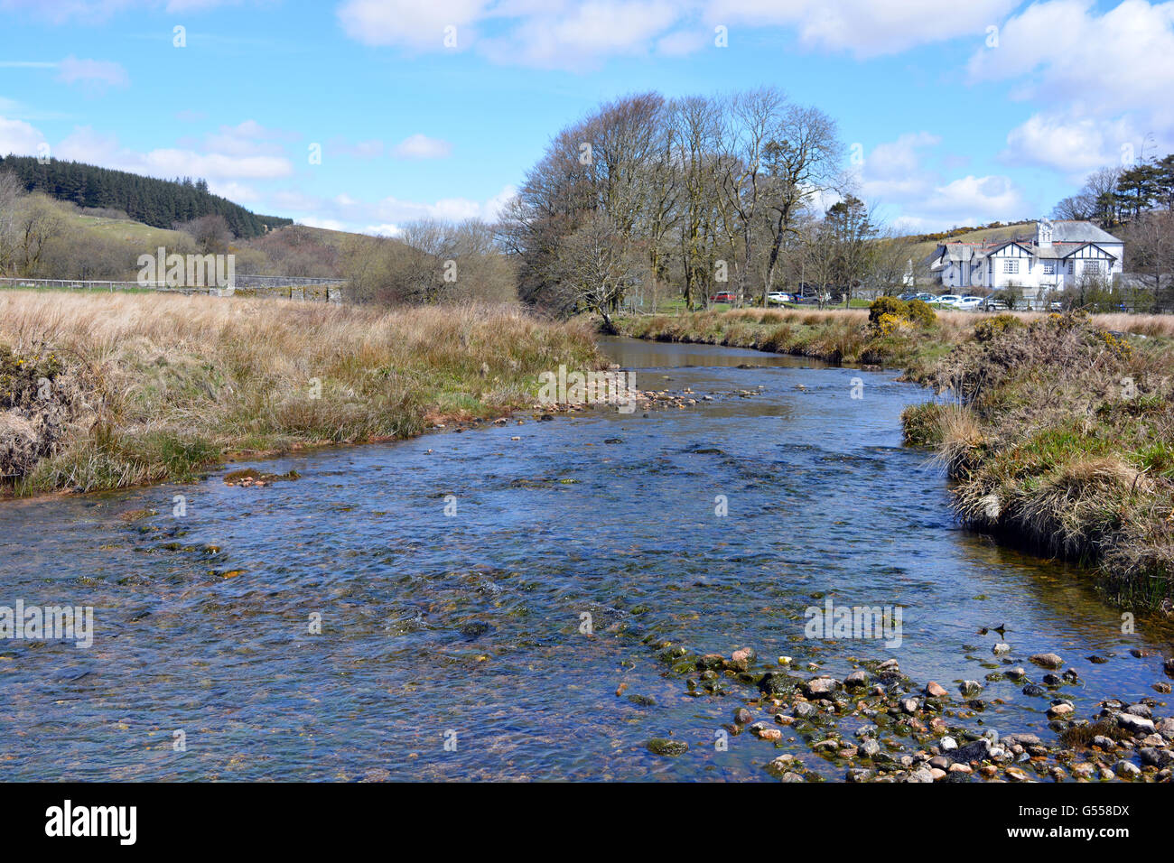 Looking towards the Two Bridges Hotel from banks of the West Dart River, Two Bridges, Dartmoor National Park, Devon. - Stock Image