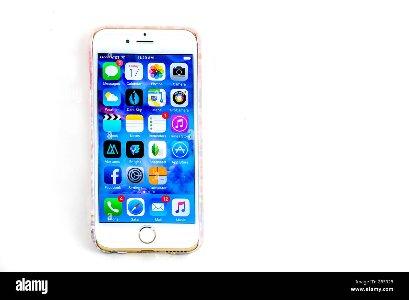 The screen of an iPhone 6s showing the home and app screen. Cutout. USA. - Stock Image