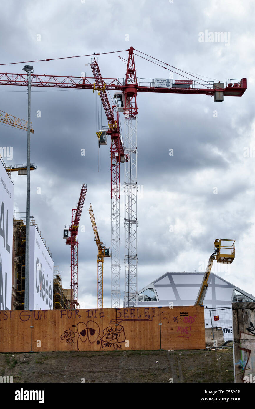 Berlin, Germany. Building cranes can be seen across the city as construction and redevelopment sites are everywhere - Stock Image