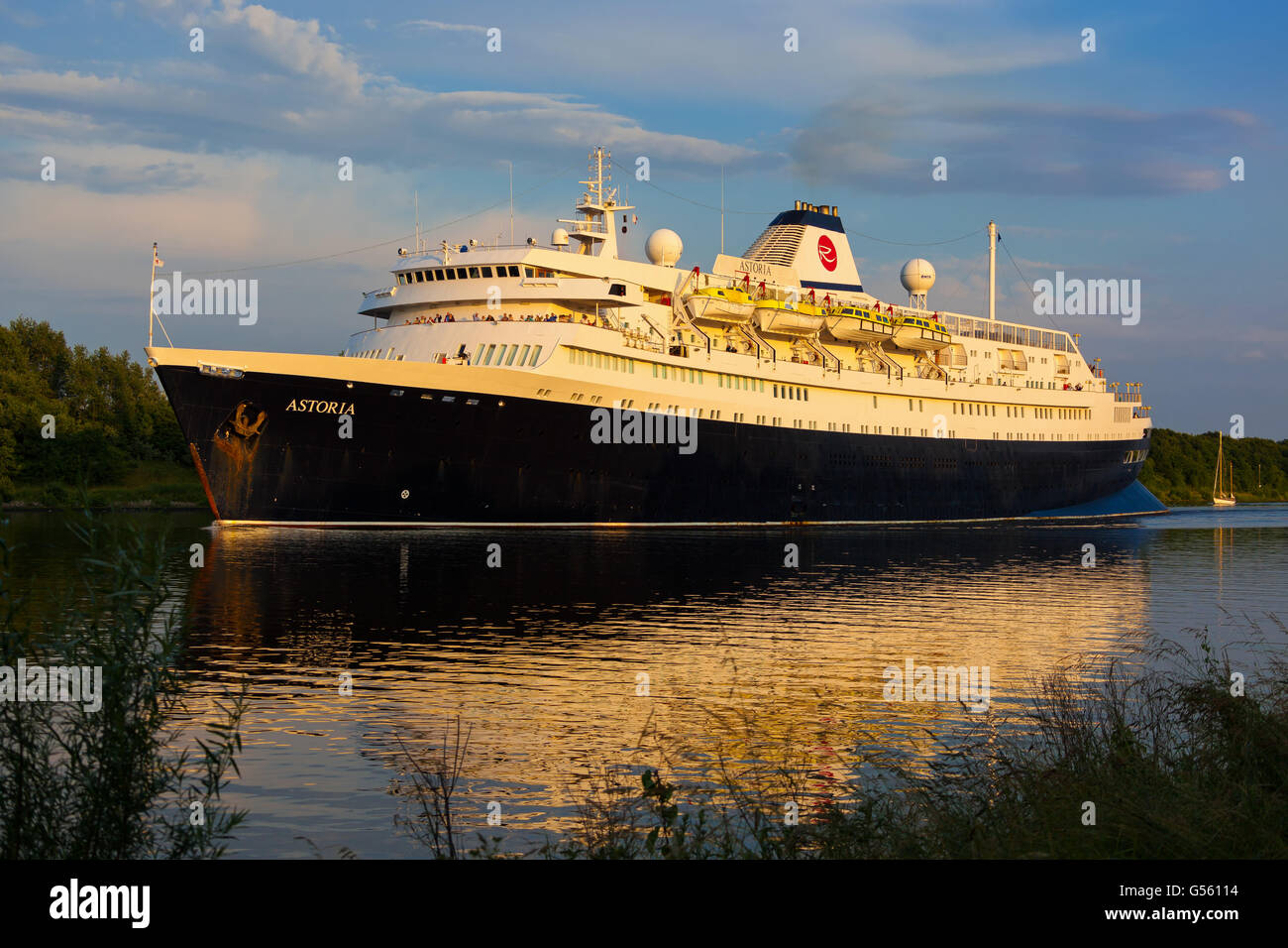 World's oldest active Ocean Liner Astoria (build in 1948) passing through the Kiel Canal on it's way from Amsterdam Stock Photo