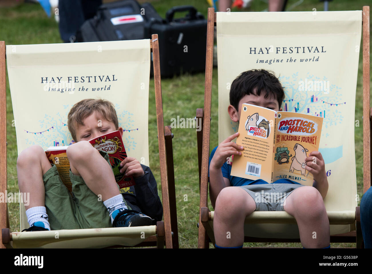 Tw Children reading books at  the annual The Hay Festival of Literature and the Arts, 'the Woodstock of the - Stock Image
