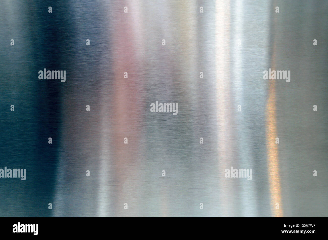 Convex polished shiny steel metal surface with multicolored reflections and glare - Stock Image