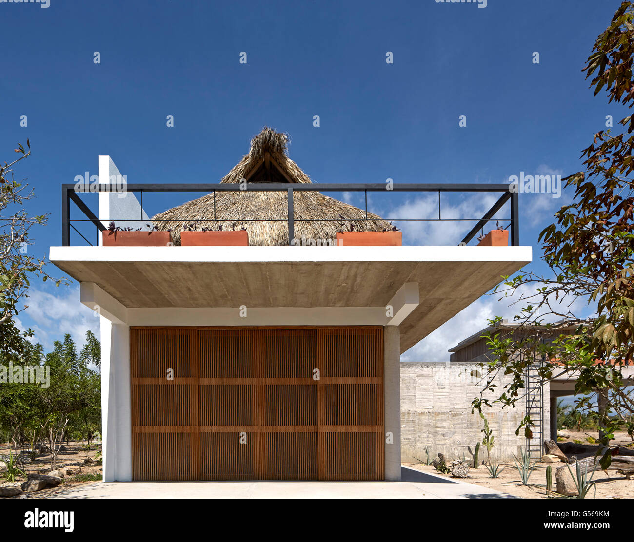 Overall exterior view from side. Casa Cal, Puerto Escondido, Mexico. Architect: BAAQ, 2015. - Stock Image