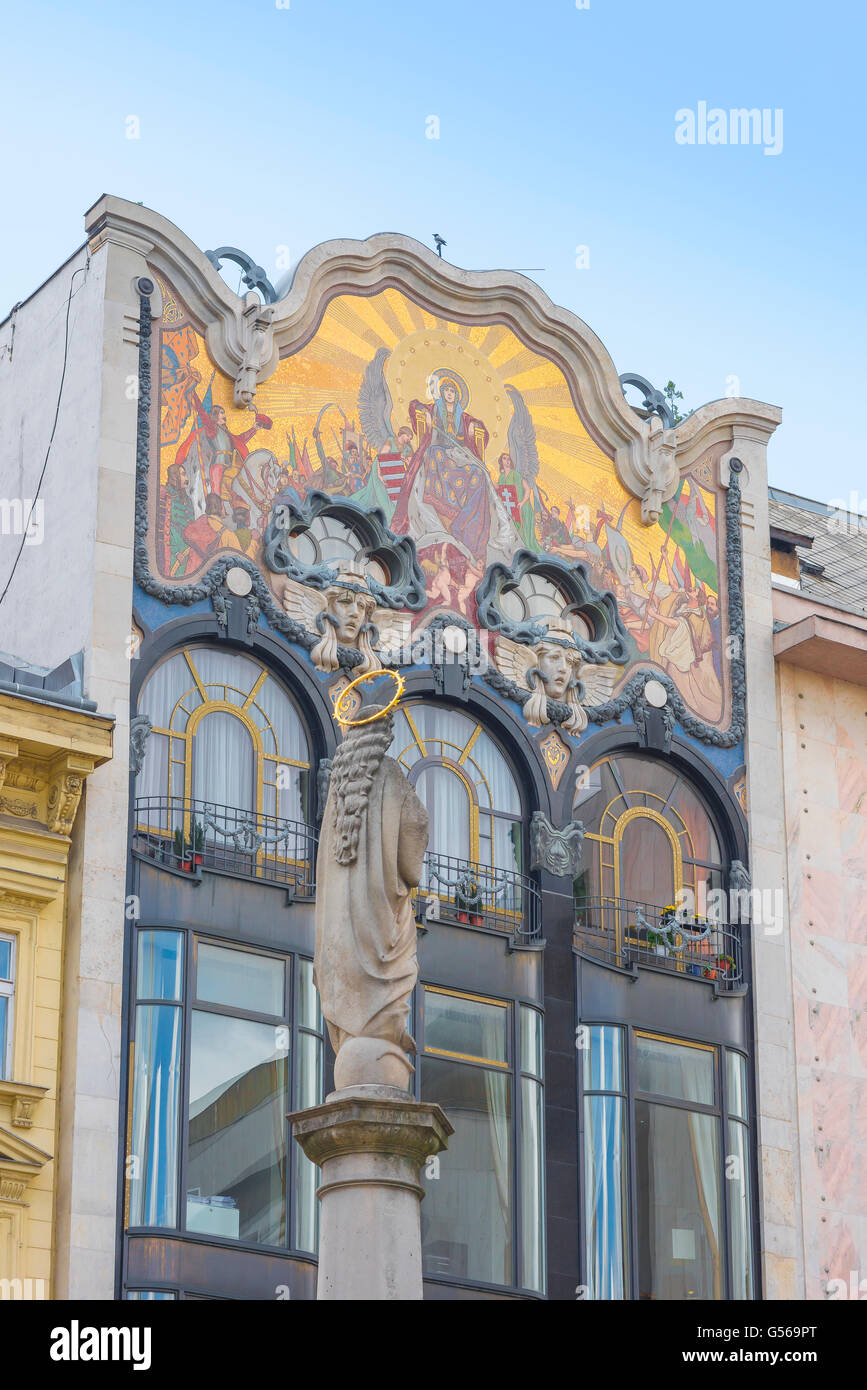 Our Lady of Hungary mosaic by Miksa Roth adorning the exterior of a building in the Belvaros area of Budapest, Hungary. - Stock Image
