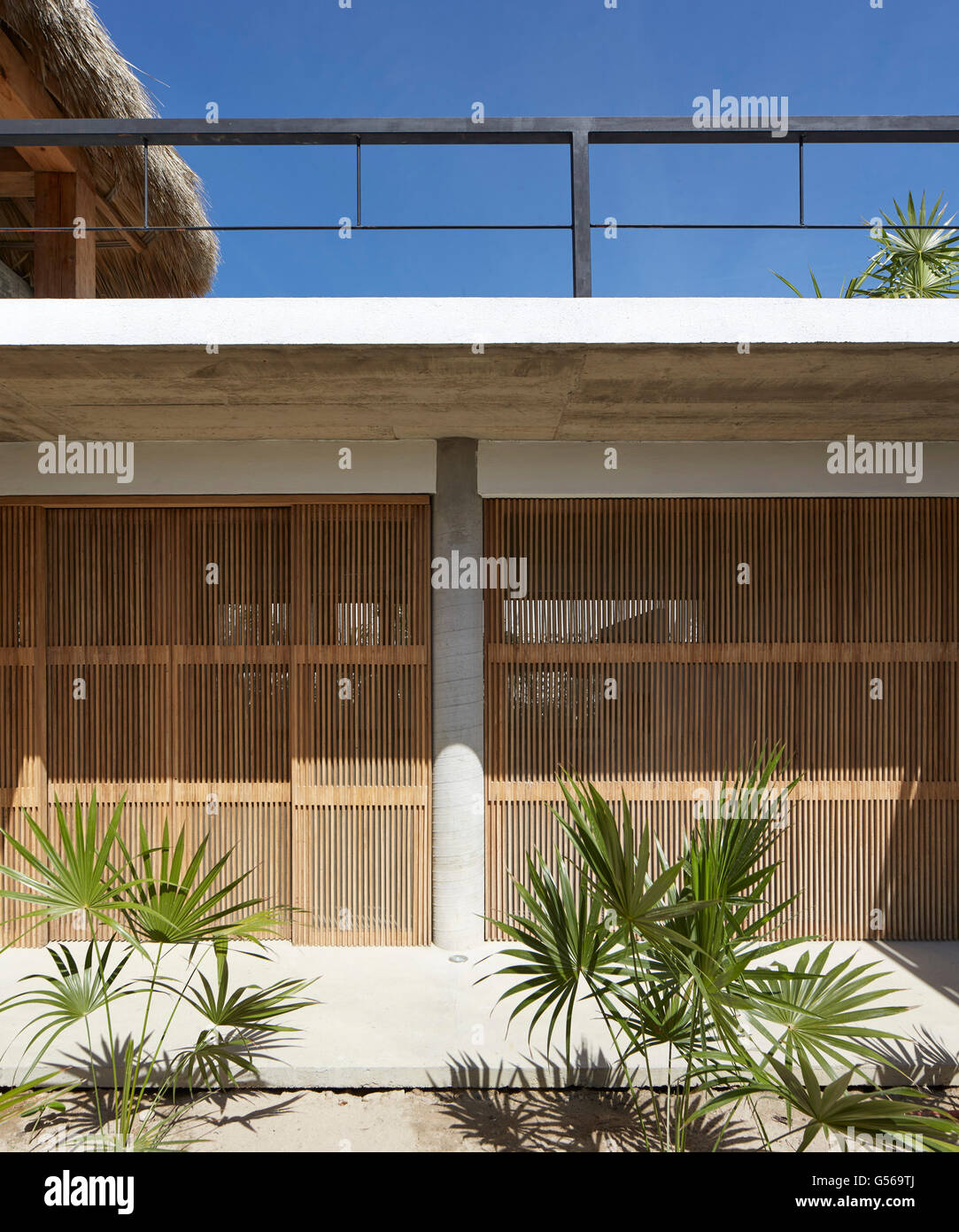 View from lower level courtyard. Casa Cal, Puerto Escondido, Mexico. Architect: BAAQ, 2015. - Stock Image