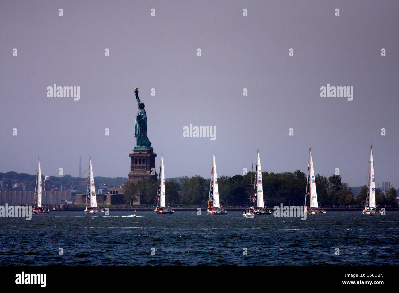 New York, USA. 20th June, 2016. Clipper Round the World ships sail past the Statue of Liberty as they leave the - Stock Image