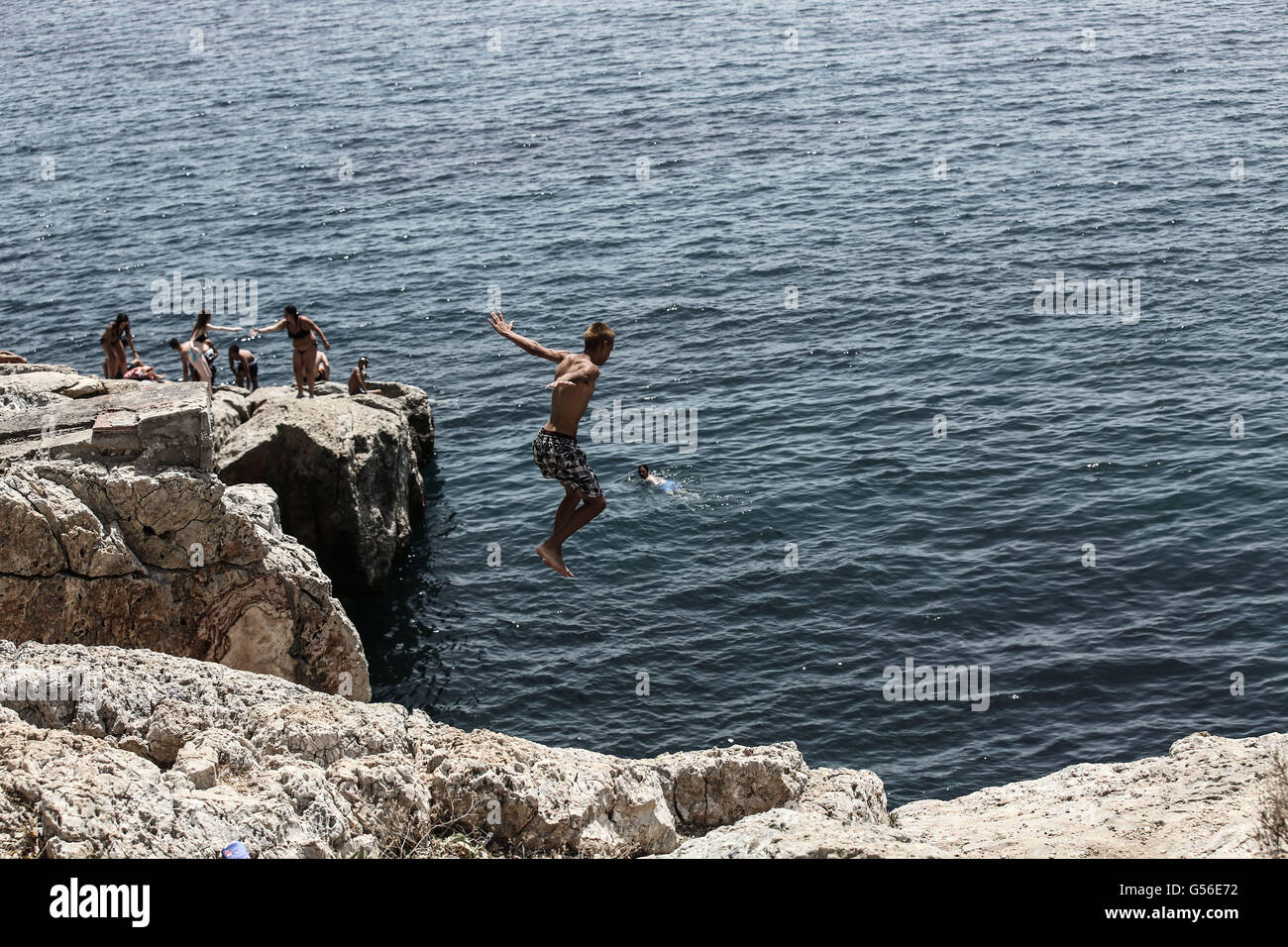 Athens. 20th June, 2016. Greek people and visitors swim at the seaside of the southern suburbs of Athens on June - Stock Image