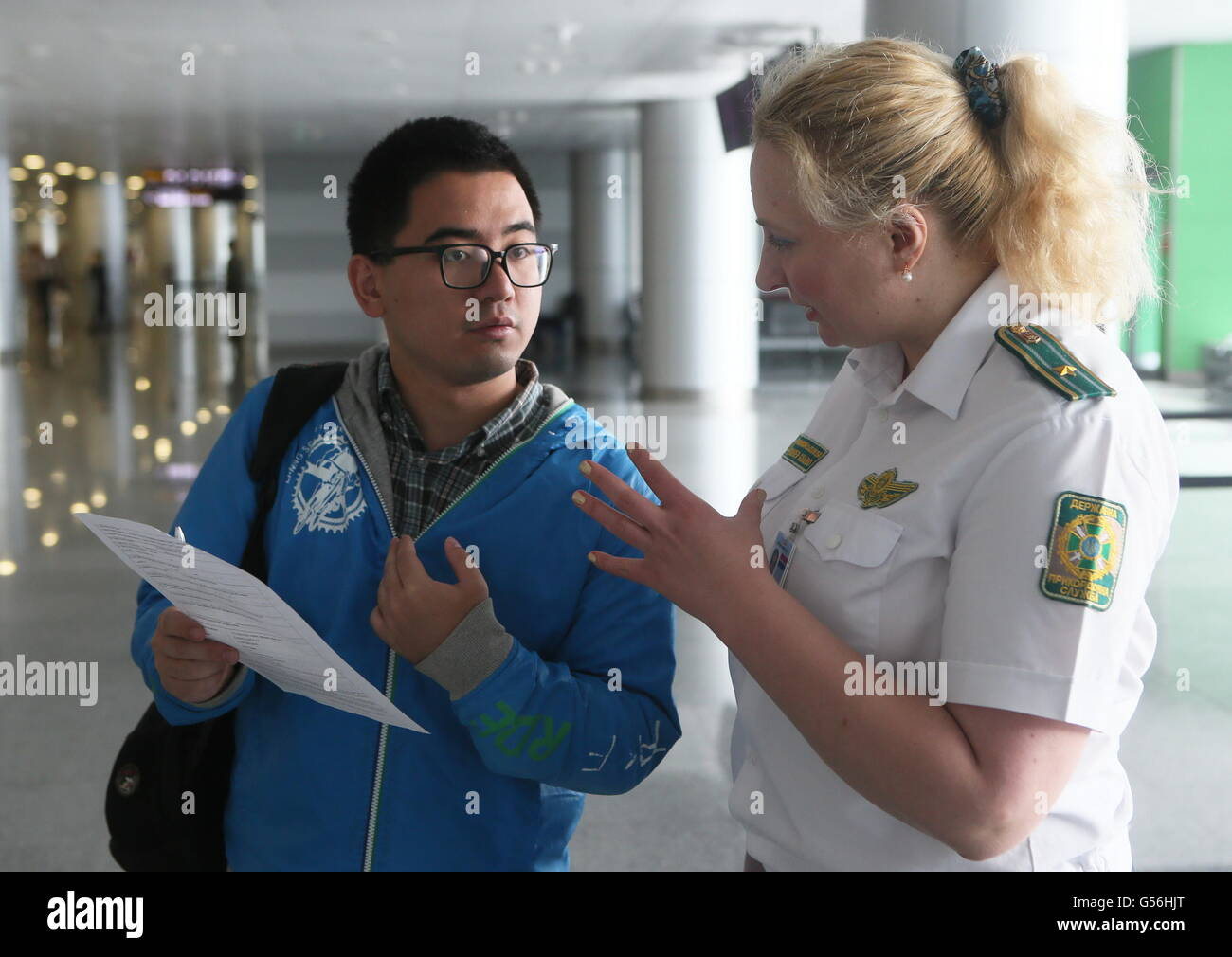 Kiev, Ukraine. 21st June, 2016. A Chinese traveller inquires the procedure of obtaining visa-on-arrival at the Boryspil - Stock Image