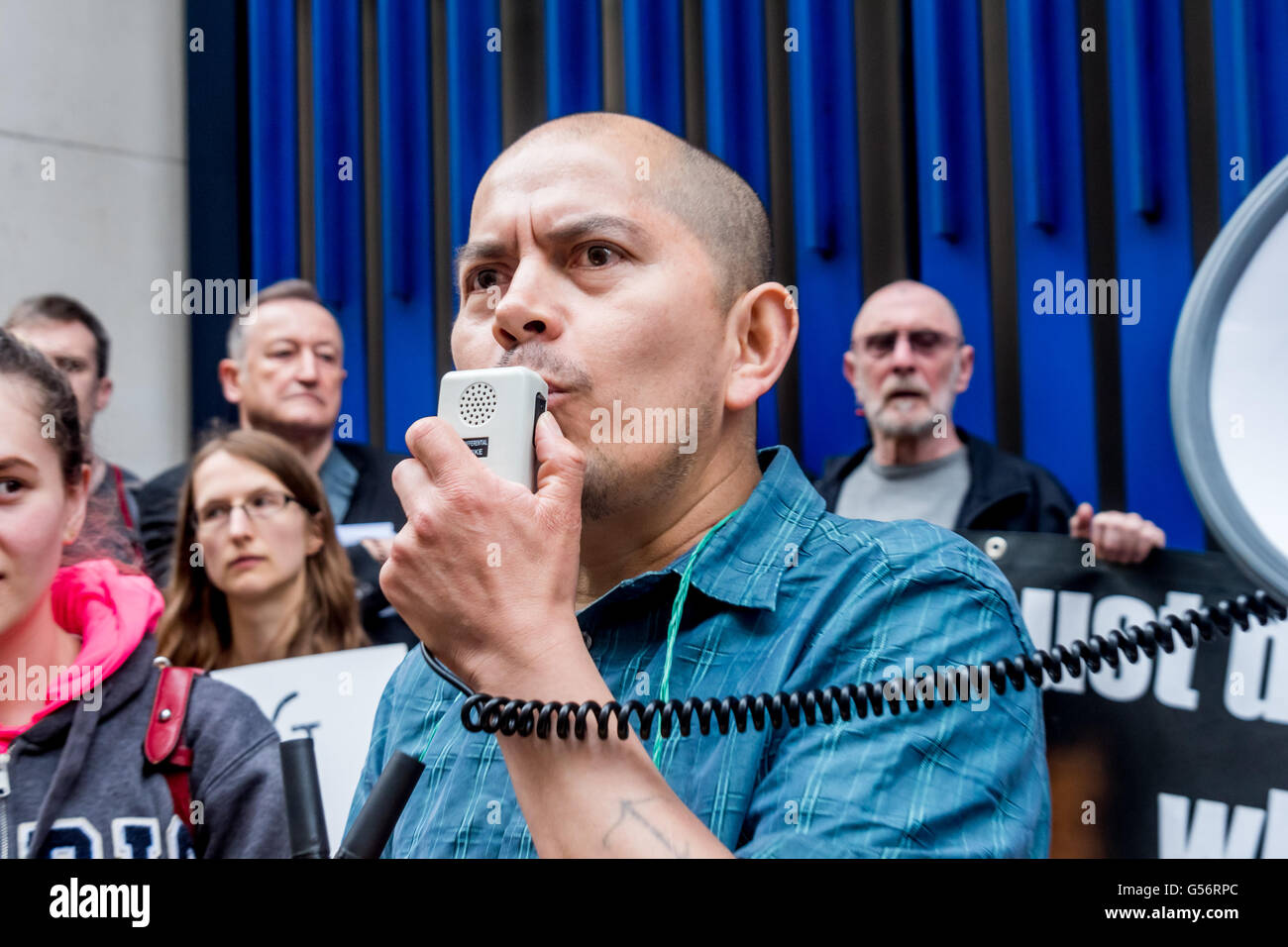 London, UK. June 21th, 2016. One of the striking cleaners speaks at the rally on the 10th day of their strike against Stock Photo