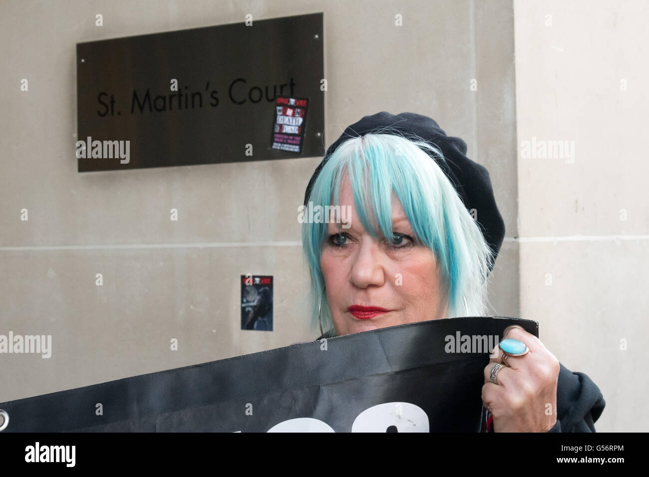London, UK. June 21th, 2016. Jane Nicholl of Class War holds their banner in front of the CBRE offices at St Martin's Stock Photo