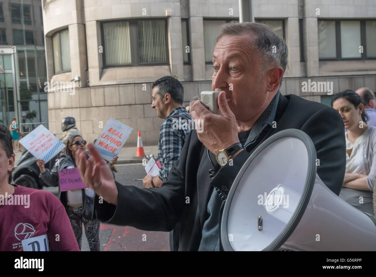 London, UK. June 21th, 2016. A speaker from the IWW brings solidarity and tells the protesters outside the St Martin's Stock Photo