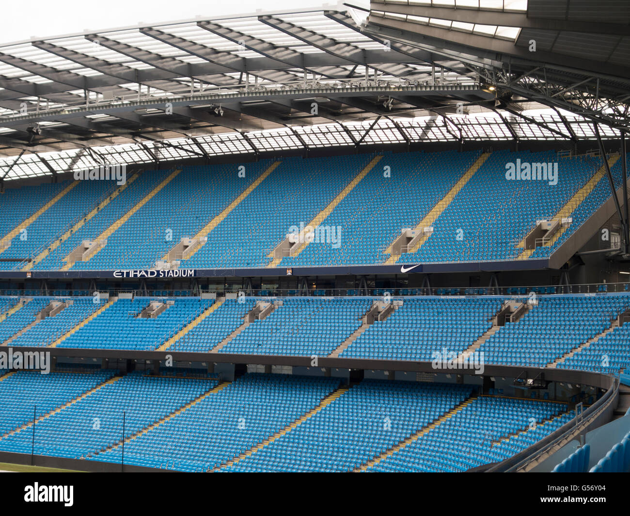 Seats inside Etihad Stadium Manchester CIty Football Club UK - Stock Image