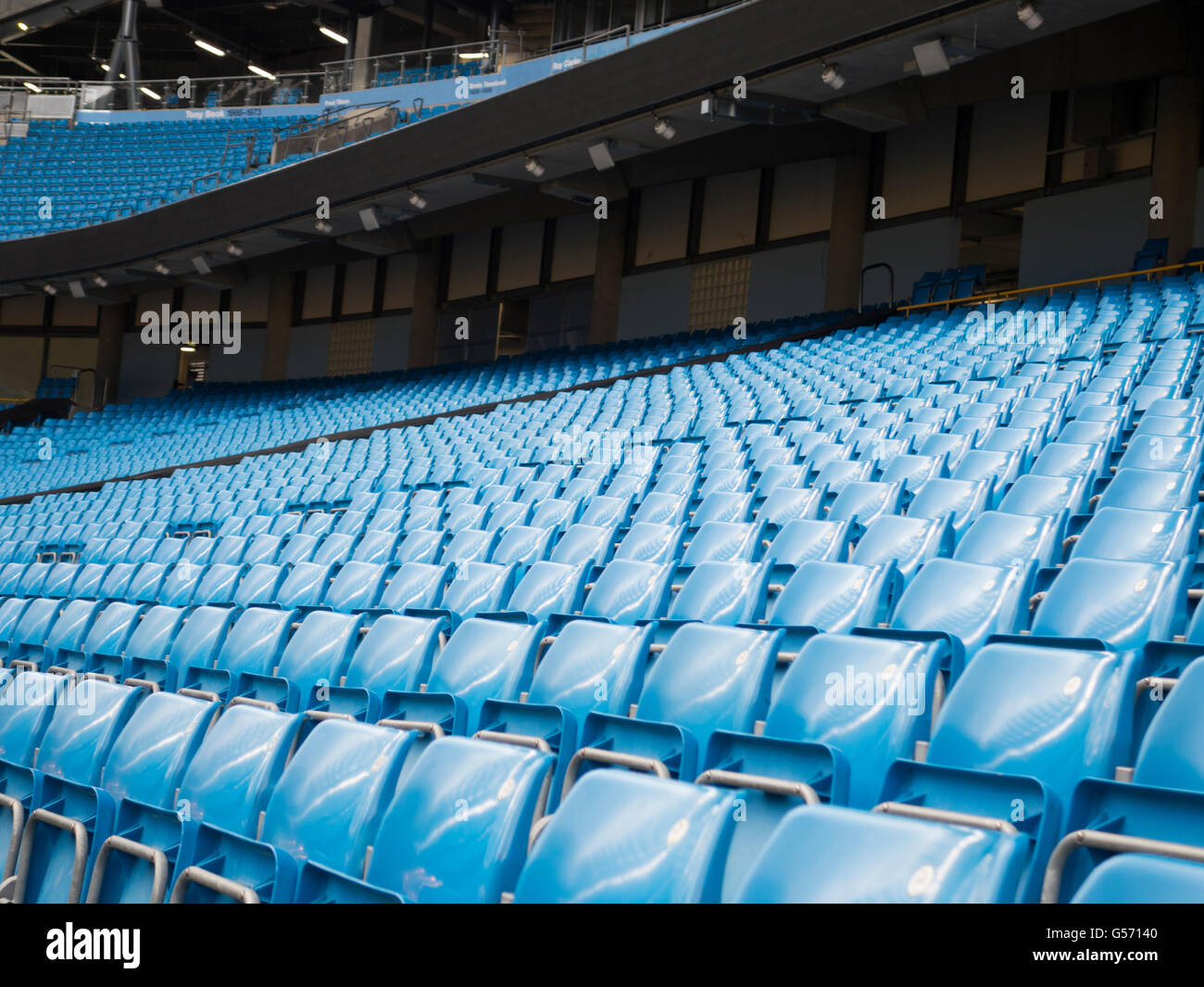 Seats inside Etihad Stadium Manchester CIty Football Club UK - Stock Image